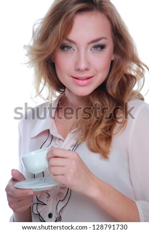 Blonde woman is holding coffee cup - stock photo