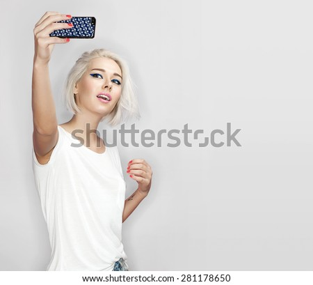 Blonde woman is photographed on a white background - stock photo