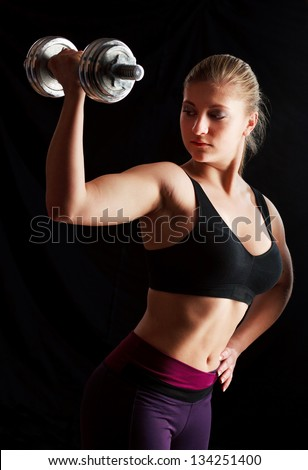 blonde woman lifting weights - stock photo