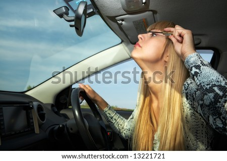 blonde woman make-up in car driving - stock photo