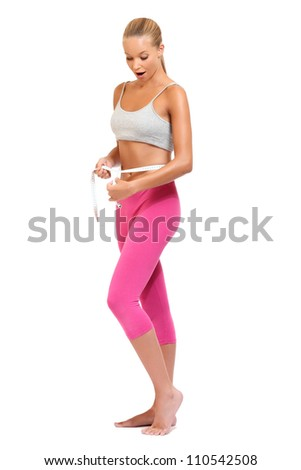 blonde woman measures her waist - stock photo