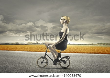 blonde woman on a bicycle