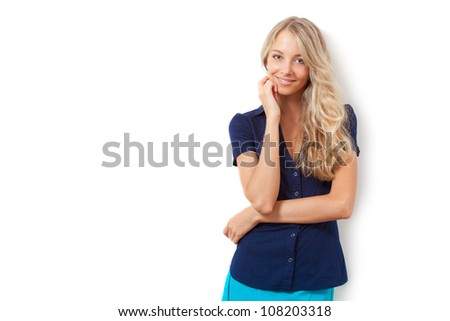 blonde woman over white wall, copy space for the text - stock photo