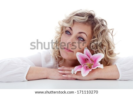 Blonde woman portrait with pink lily flower - isolated - stock photo