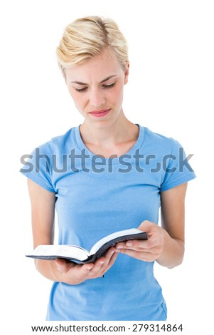 Blonde woman reading bible on white background - stock photo