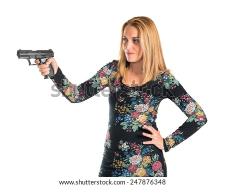 Blonde woman shooting with a pistol  - stock photo