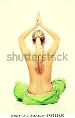 Blonde woman sitting in yoga pose - stock photo