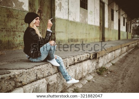 Blonde woman urban fashion portrait
