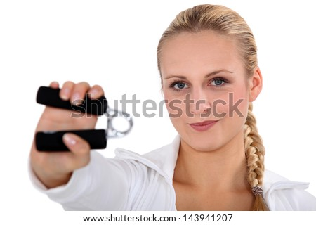 blonde woman using hand grip