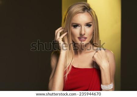 Blonde woman wear red dress - stock photo