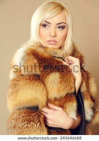 Beautiful blonde in fur coat very