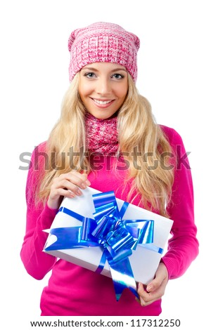 blonde woman wearing knitwear  holding gift box over white background - stock photo