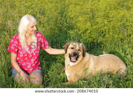 Blonde woman with big Mastiff dog