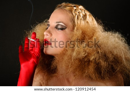 Blonde woman with creative hairstyle smoking a cigarette