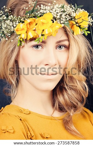 Blonde Woman with Flowers. Natural  Makeup - stock photo