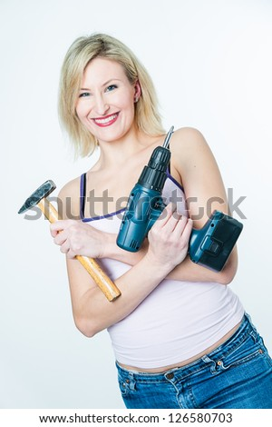 Blonde woman with hammer and screwdriver in her hands