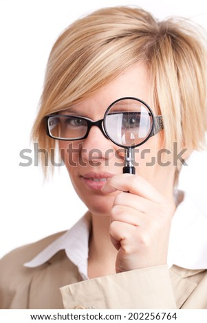 blonde woman with magnifying glass - stock photo