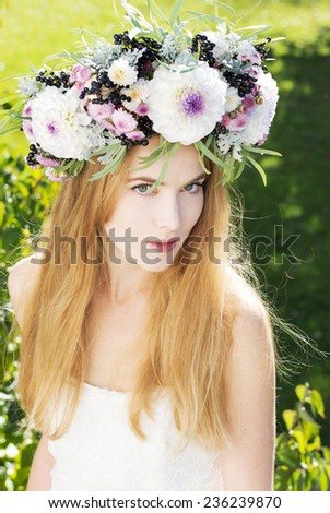 Blonde woman with white aster wreath smiling - stock photo