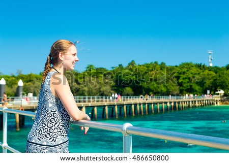 Blonde young girl relaxing at Green Island in Cairns, Queensland, Australia