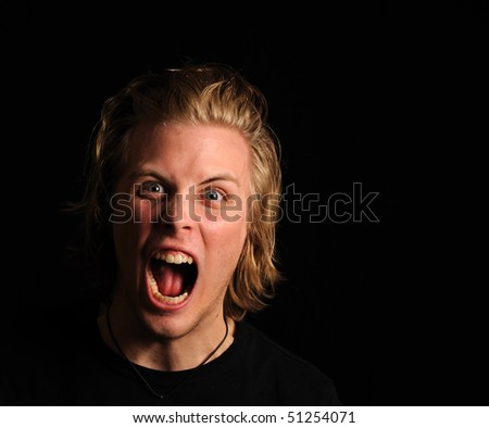 Blonde young man screaming