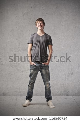 Blonde young man smiling - stock photo