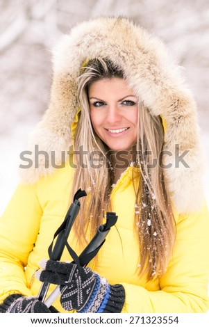 Blonde young smiling woman with ski at winter time. Fair caucasian girl have fun with skiing - stock photo