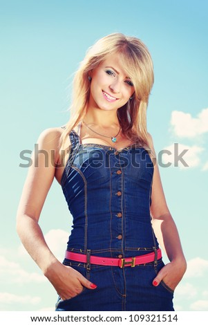 Blonde young woman in blue jeans denim - stock photo