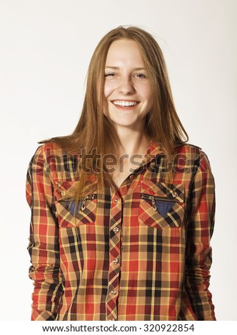 Blonde young woman with colorful shirt and beauty smile. - stock photo