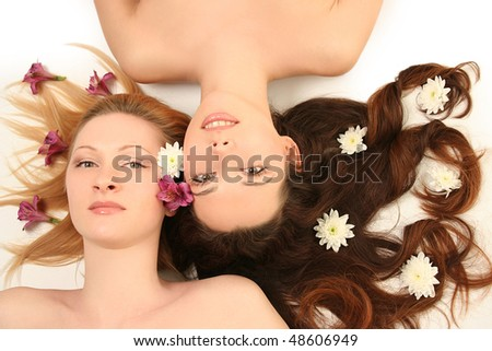 blondy and brunette on white background - stock photo