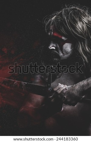 Blood concept, man with big sword, red stains - stock photo