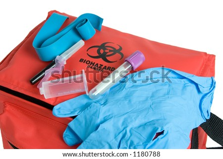 Blood drawing kit showing the biohazard transport bag, rubber, gloves, laboratory tube, tourniquet, and needle. - stock photo
