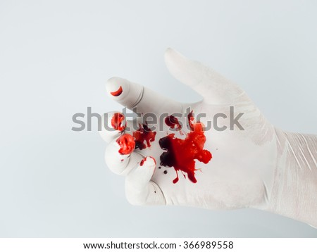 Blood drops on glove. - stock photo