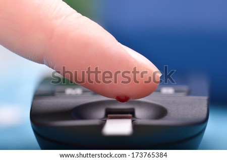 Blood glucose meter and finger  - stock photo