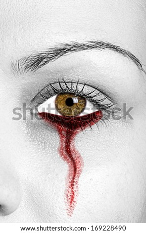 Blood leaking from woman eye - stock photo