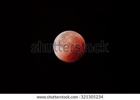 Blood Moon - This is a picture of the Moon during the Lunar Eclipse on September 28, 2015. - stock photo