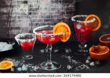 Blood Orange Margarita in glass with salted rim. - stock photo
