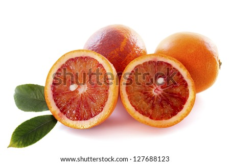 blood oranges in front of white background