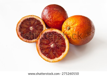 Blood oranges on white background
