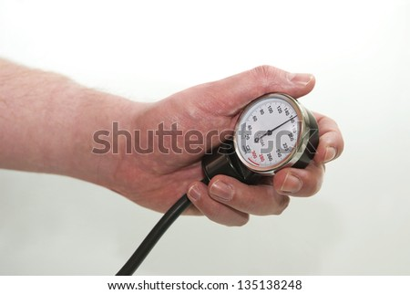 Blood pressure gage showing high blood pressure in the human hand