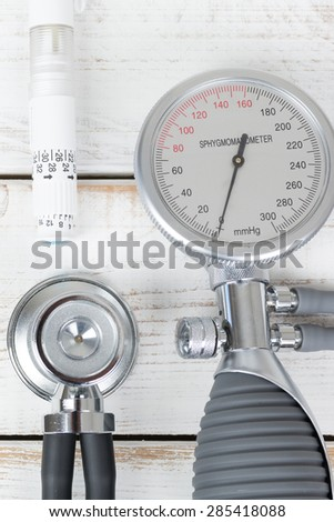 Blood pressure gauge and stethoscope and insulin pen