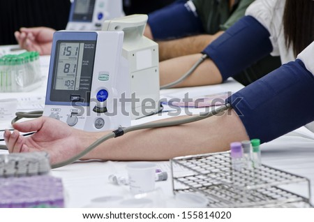 Blood pressure measuring. - stock photo