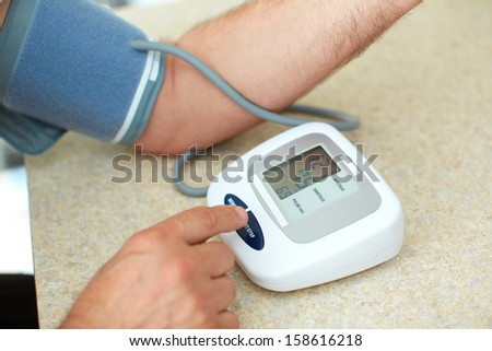 Blood pressure measuring. Doctor and patient.  Health care.