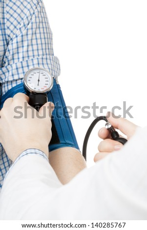 Blood pressure measuring. Doctor measuring patients blood pressure - studio shoot