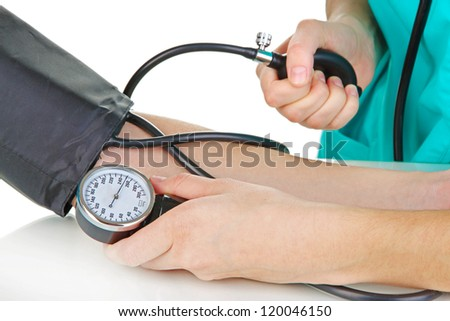 Blood pressure measuring isolated on white - stock photo