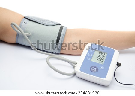 Blood pressure meter showing a normal blood pressure with woman arm - stock photo