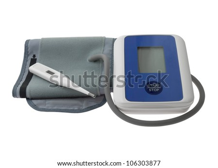 Blood pressure monitor  and blister capsule on white background