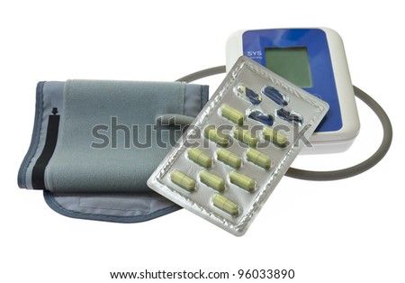 Blood pressure monitor  and blister capsule on white background - stock photo