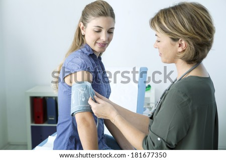 Blood Pressure, Woman - stock photo