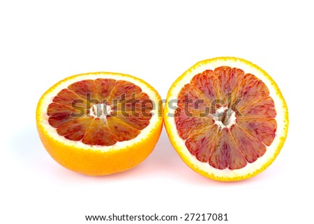 Blood (red-pulp Malta) orange sliced on halves isolated on the white background
