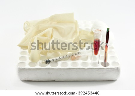 Blood sample in tube blood for screening test and syringe on white background. - stock photo